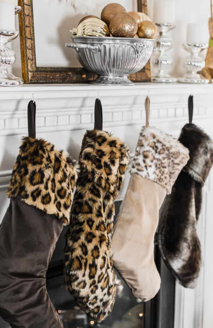 neutral animal print stockings hanging from mantel