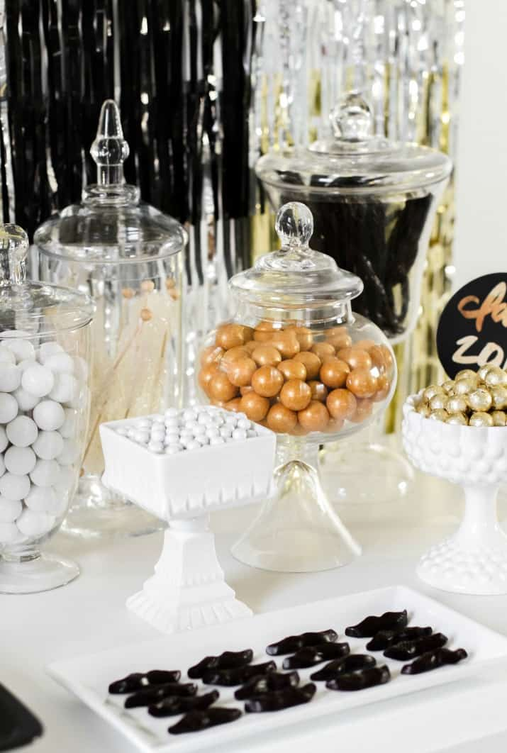 dessert table, gold and white candies in jars