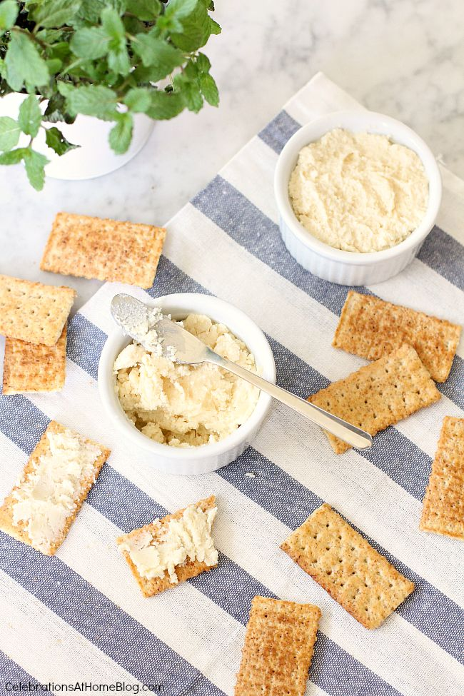 beer cheese spread recipe in white ramekins with club crackers, overhead view