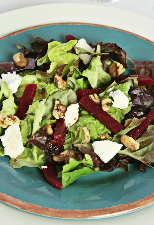 Beet & goat cheese salad is a terrific starter course for any dinner party. You'll enjoy the combination of flavors and textures in this easy dish. #saladRecipe #beetGoatcheeseSalad