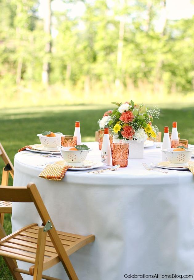 Summer entertaining orange tablescape outdoors