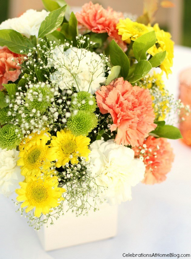 Summer entertaining floral centerpiece in orange and yellow