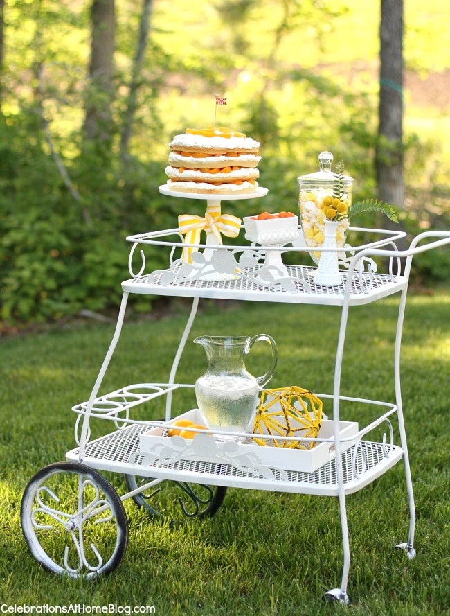 Summer entertaining garden cart with cake and drinks