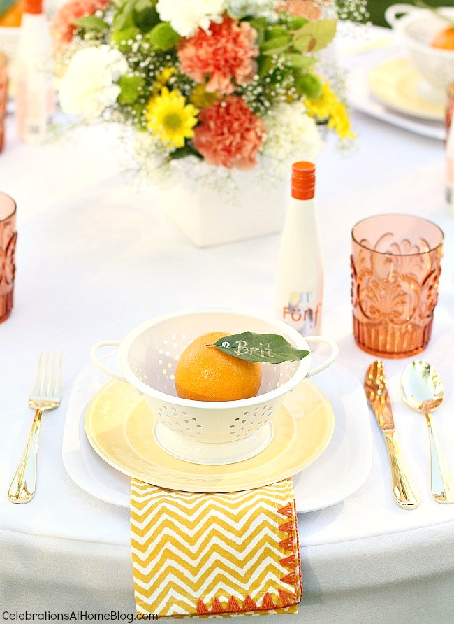 Summer entertaining place setting, orange and white and yellow