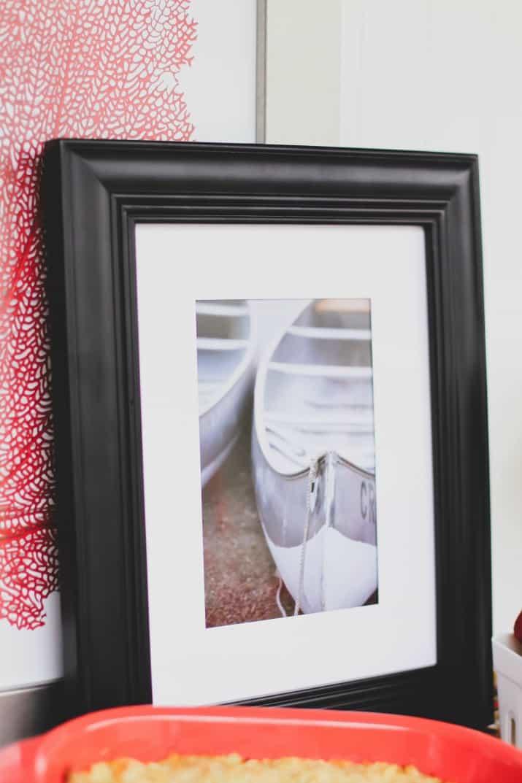 framed boat photo for shrimp boil dinner party decor