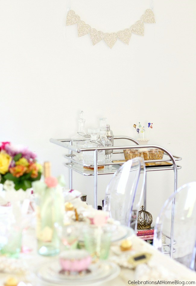 You'll get inspired by this beautiful bridesmaid luncheon with menu & recipes in a modern-meets-vintage style. Would be beautiful for any ladies luncheon or tea party! - bar cart & heart swag