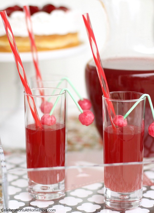 cherry cocktail recipe in glasses with candy cherry garnish