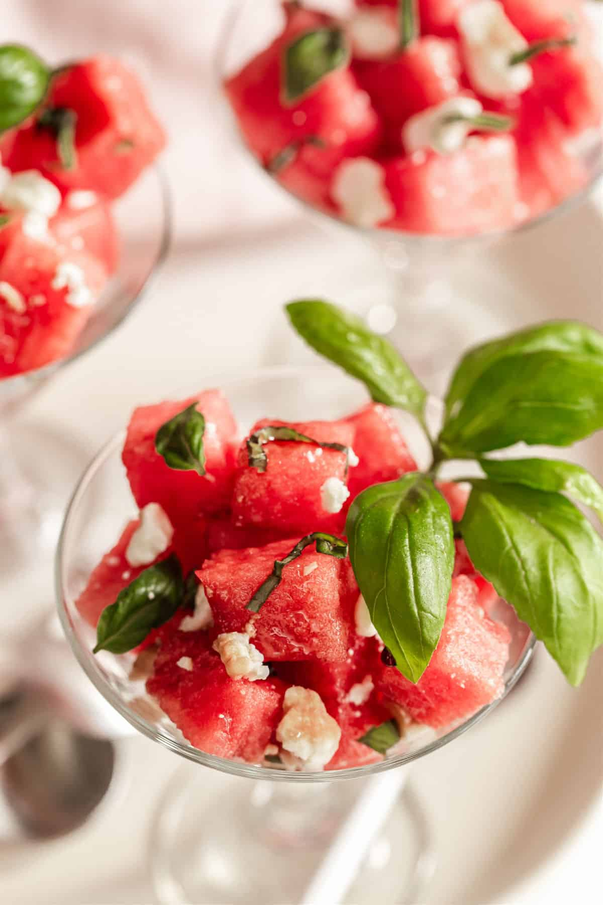 mini glasses filled with watermelon salad