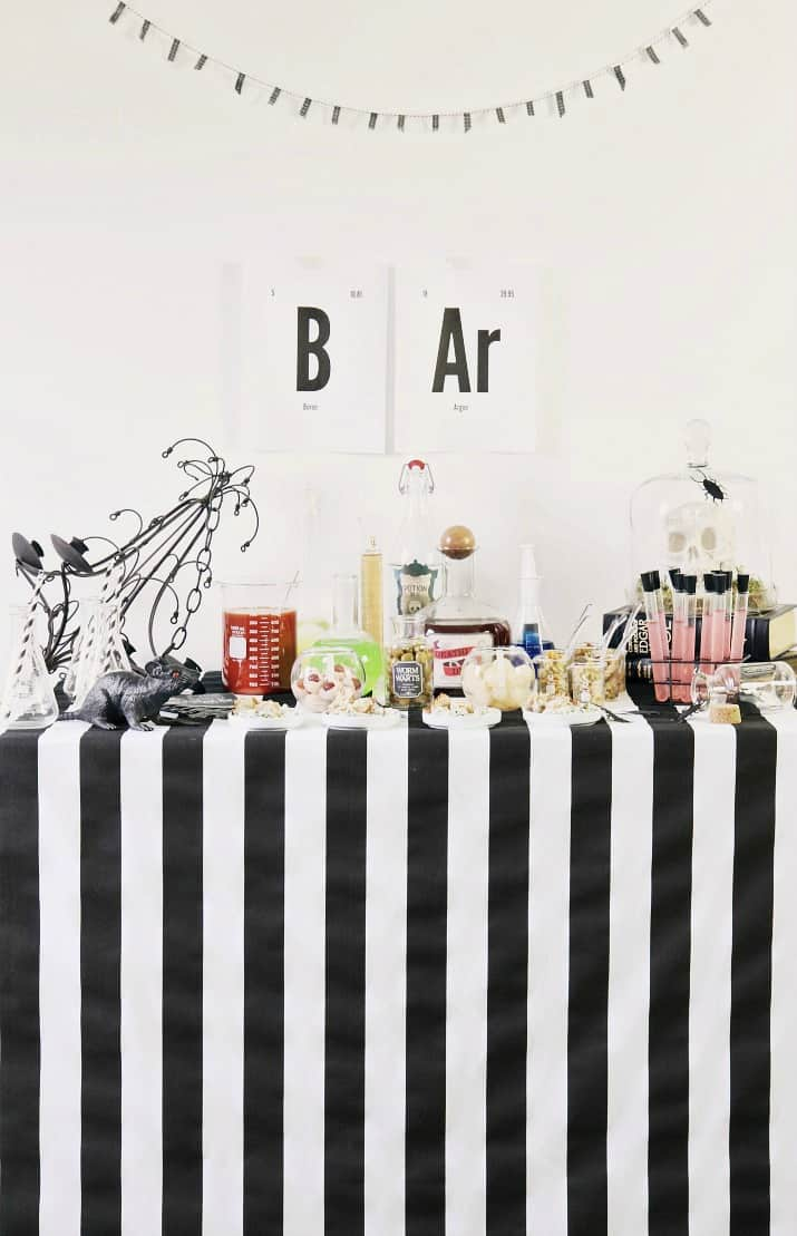 Halloween bar, black and white stripe table cloth, science lab theme