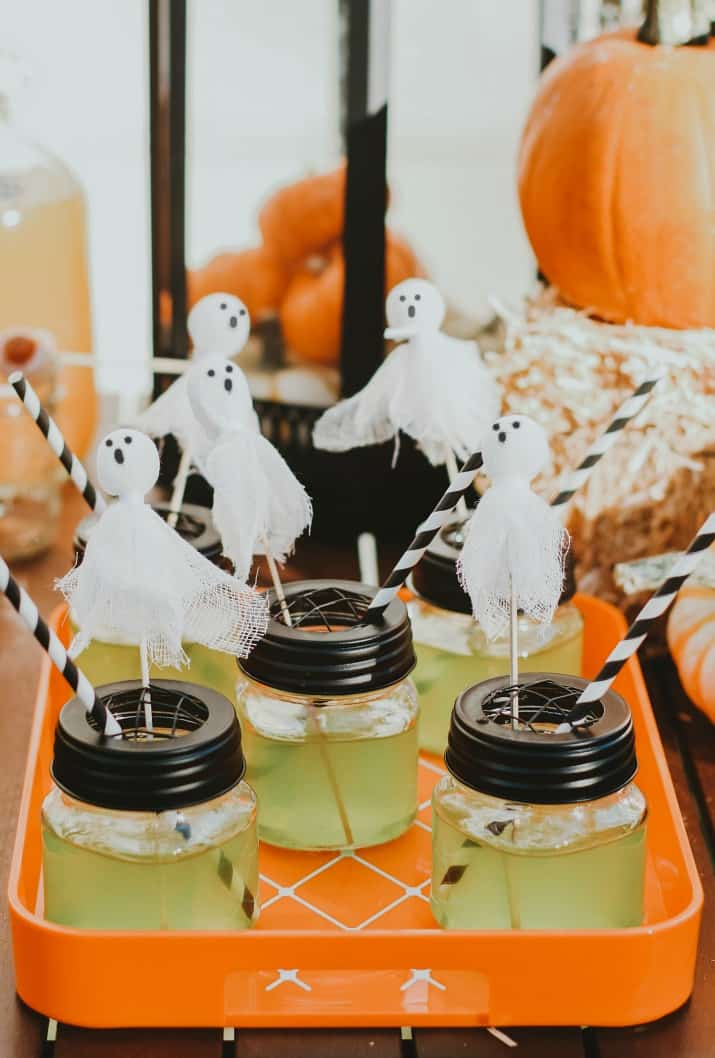 Halloween party drinks with ghost stirrers