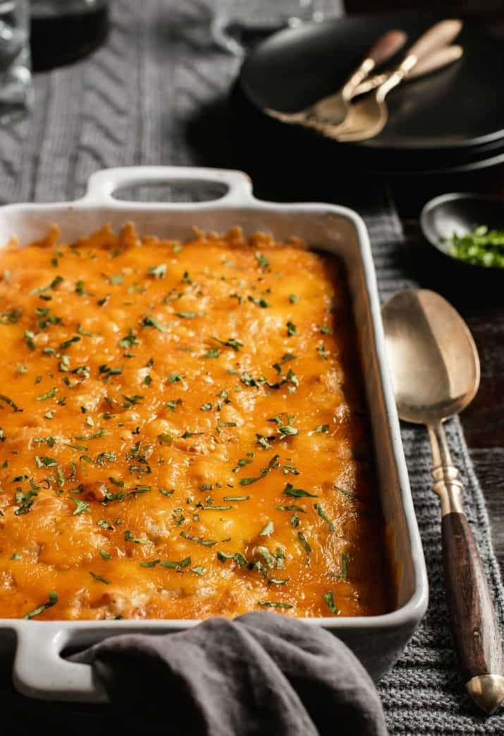 cheesy casserole in white dish, front view