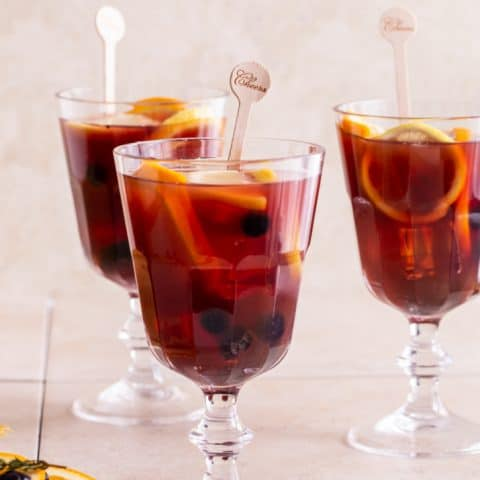 red sangria in three stemmed glasses
