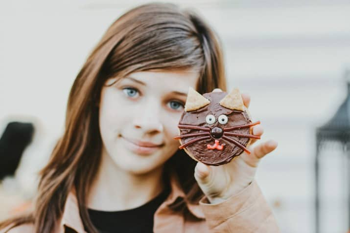 girl holding cat cookie