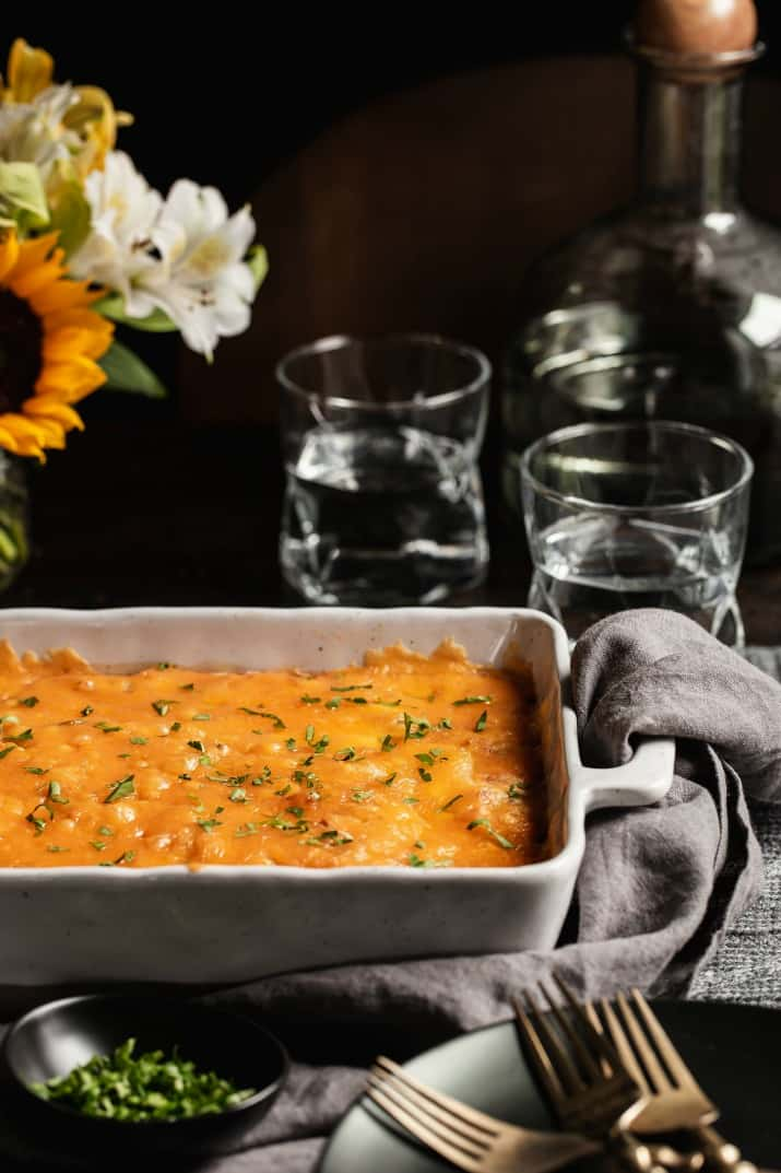 cheesy casserole on dinner table