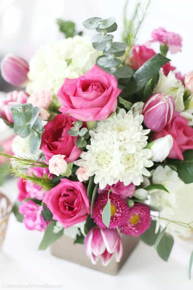 Get Pink Party Ideas like this pink and white floral centerpiece for a pink bridal shower, a pink birthday celebration, or breast cancer awareness month.