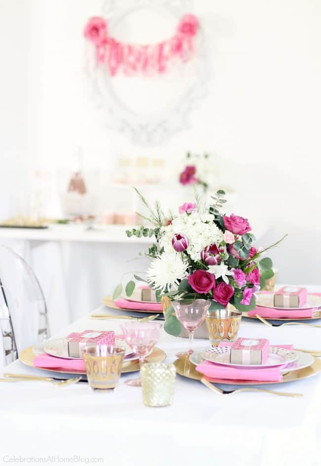 Get pink party ideas like this pink and white tablescape, for breast cancer awareness, a pink bridal shower, or a pink birthday celebration., here.