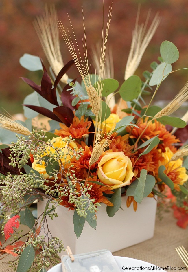 Set a simple and elegant Thanksgiving table with these ideas and inspiration. - fall flower arrangement