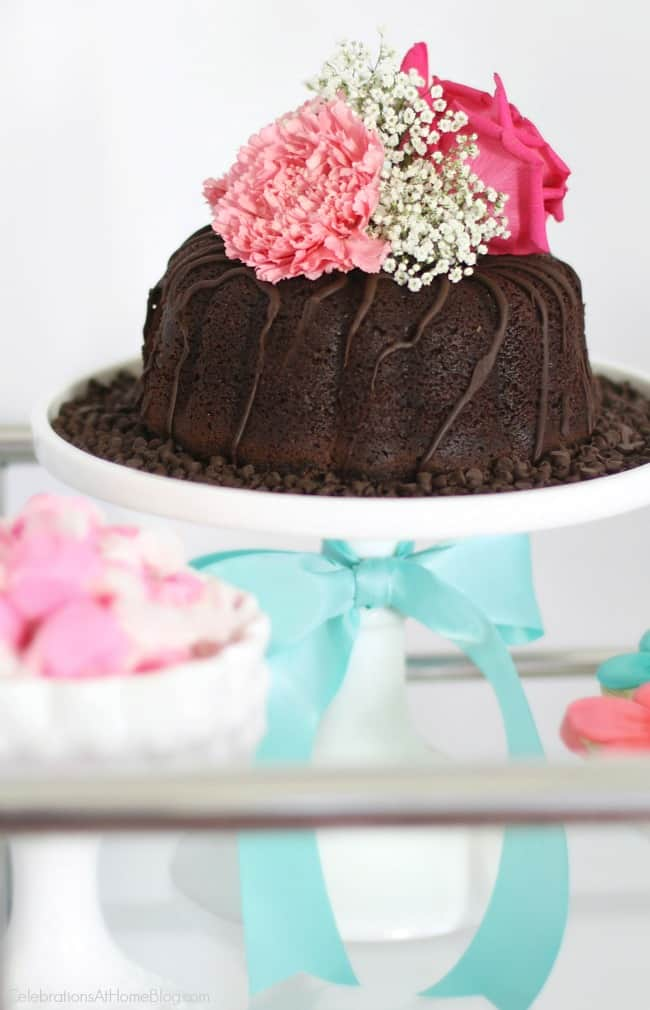 Get ideas from this baby shower inspiration shoot. Lots of decor and tips! Baby shower cake topped with flowers.