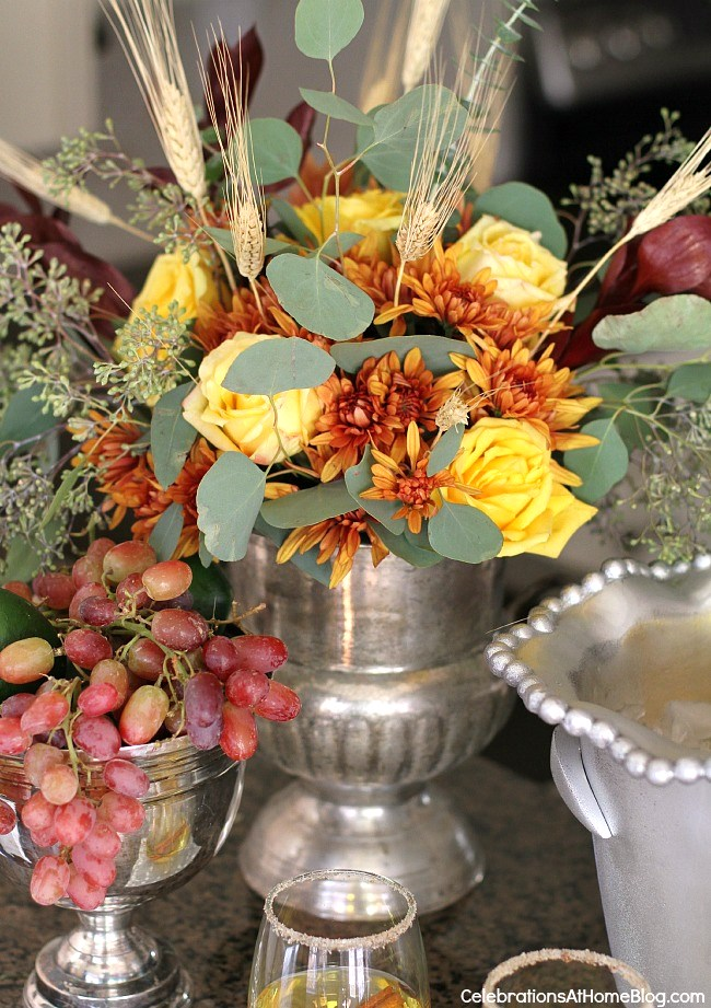 Holiday appetizers & a cocktail are the perfect way to entertain at home. Pretty seasonal flowers.