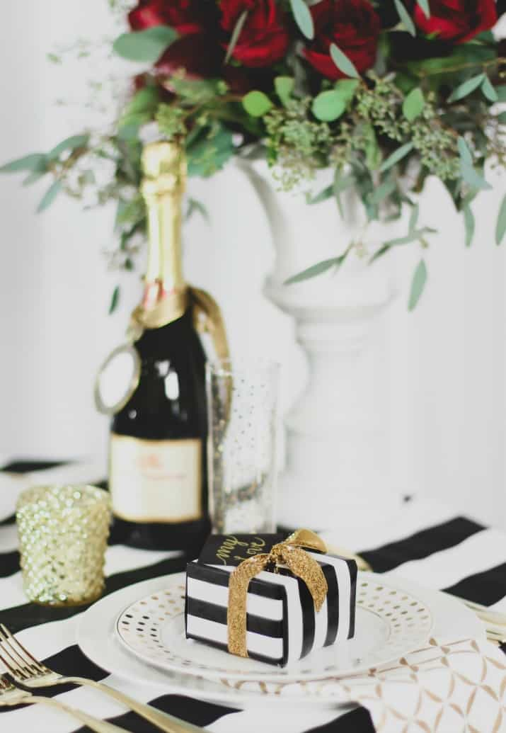 Romantic Tablescape for Two decorated with stripe table cloth and white and gold dishes