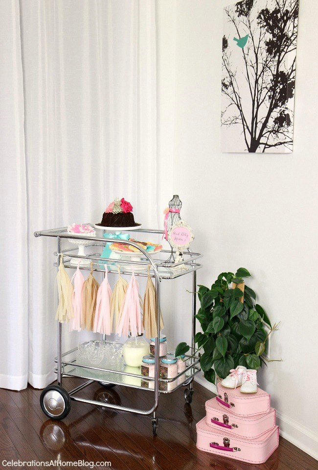 Get ideas from this baby shower inspiration shoot. Lots of decor and tips like serving dessert and drinks on a vintage bar cart.