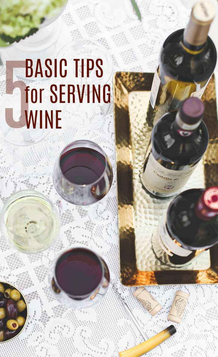 5 basic tips for serving wine, overhead image of wine bottles and glasses on white table