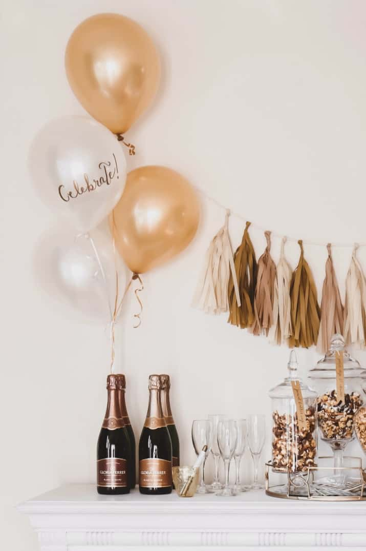 popcorn & champagne bar, gold and white balloons