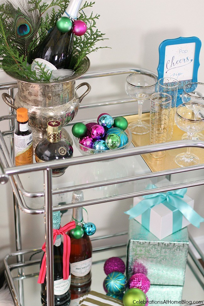 Christmas themed bar cart with blue, green and pink