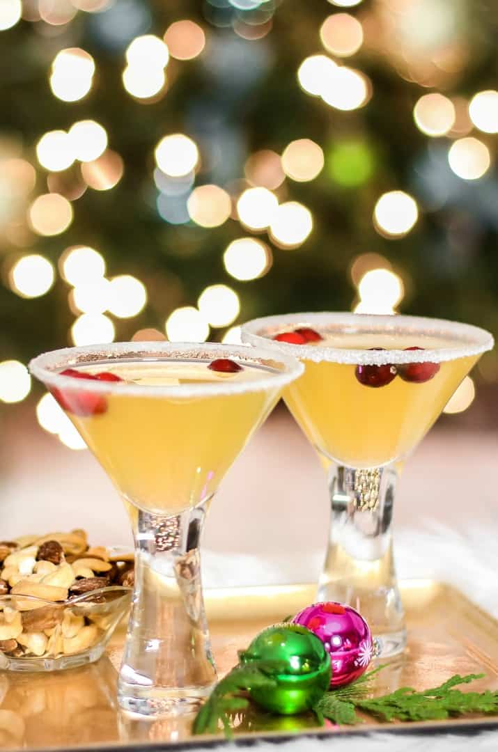 Christmas cocktails in front of lighted tree