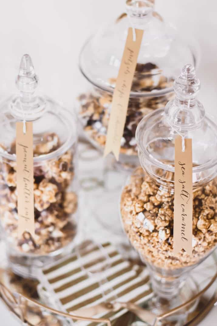 popcorn in apothecary jars with label tags