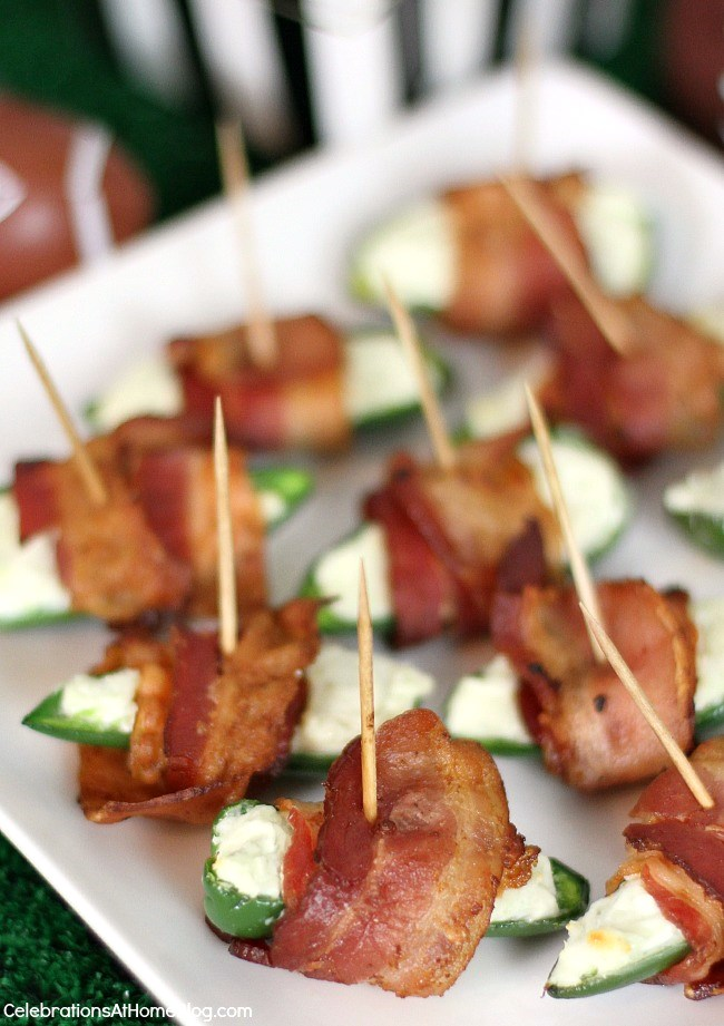 Jalapeno poppers with blue cheese are the perfect party food for casual entertaining. The creamy blue cheese tames the heat of the pepper as bacon tops it all to perfection.