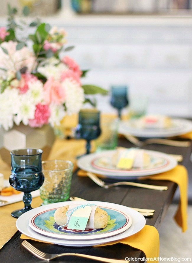 Spring table place settings; See how to add more color to the dining table with 2 different looks for Spring entertaining. I've set one table, two different ways using the same items. See what I changed, here.