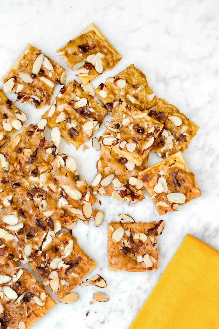 saltine cracker toffee flat lay with yellow napkin