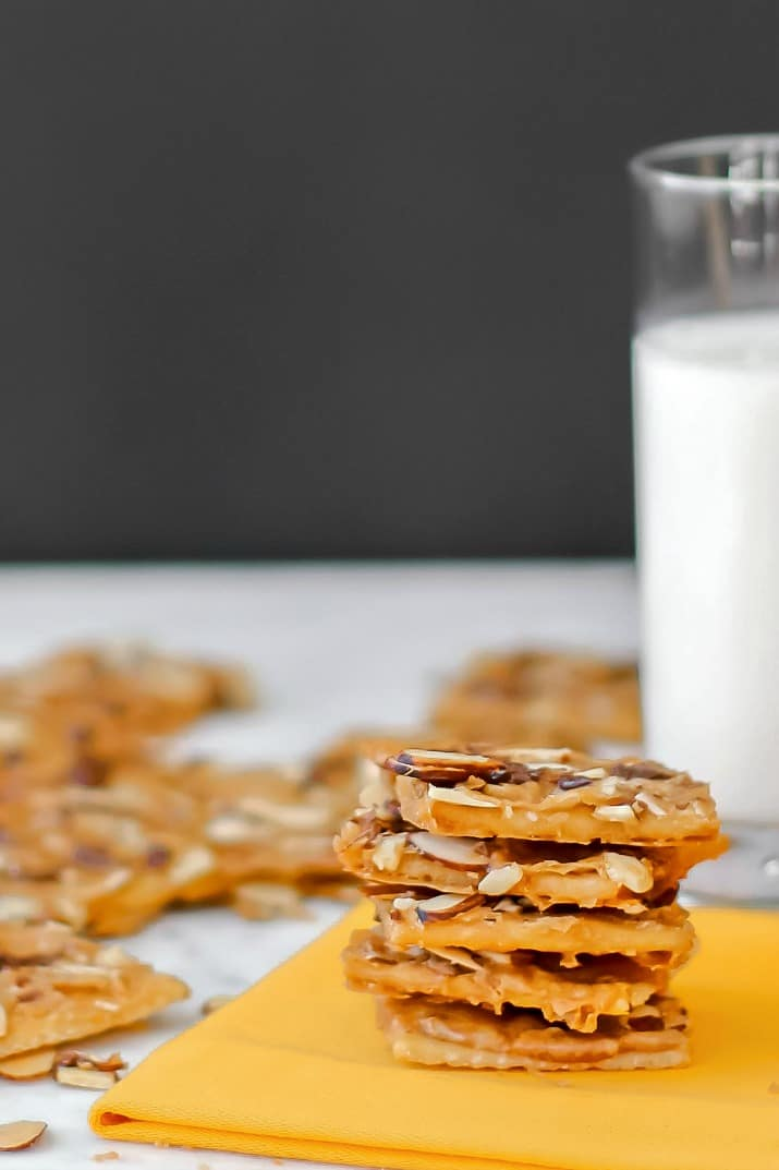 saltine cracker toffee stacked with a glass of milk
