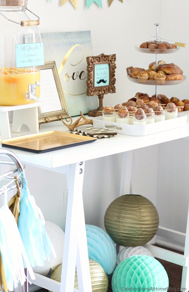 an aqua blue and gold sip and see baby shower brunch with pretty details and
