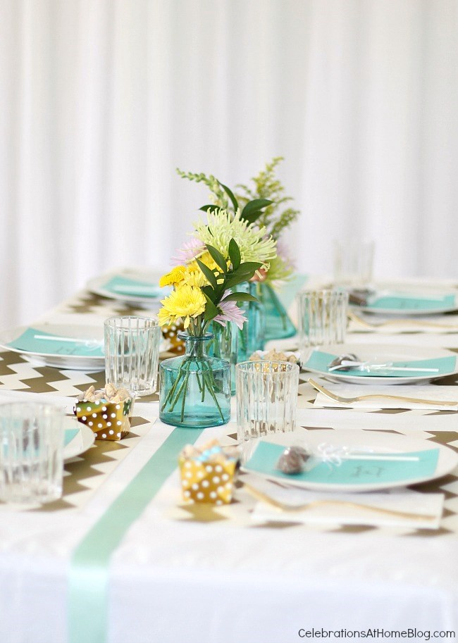 An aqua blue and gold sip and see baby shower with pretty details and ideas to inspire you.