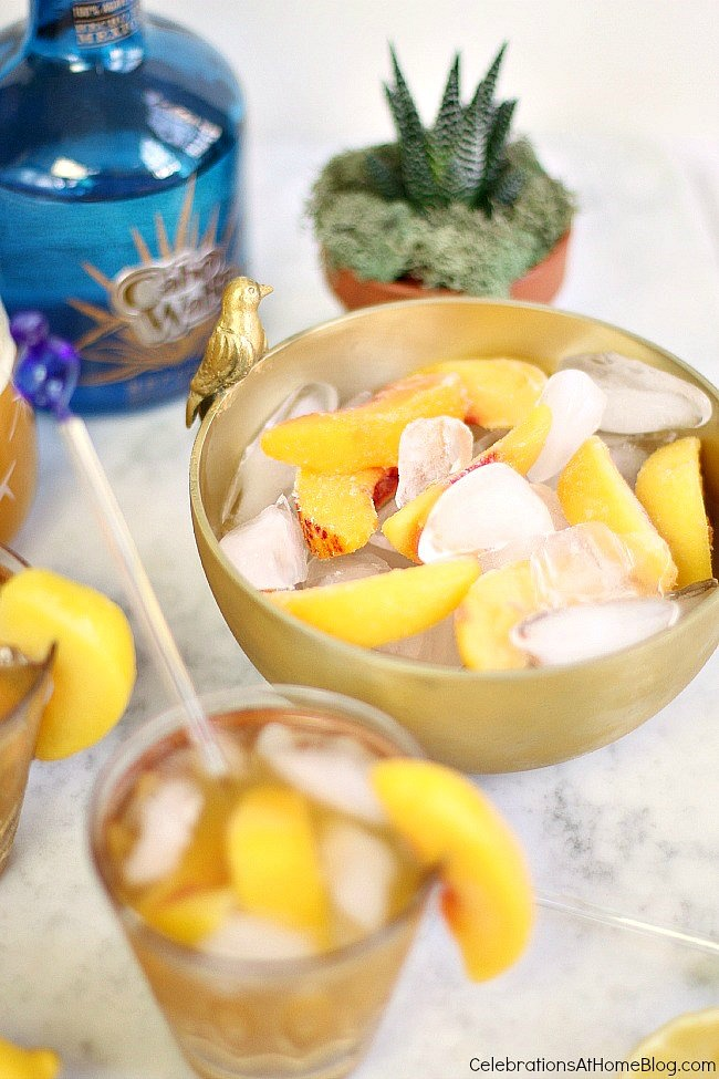 Try this sparkling peach margarita for a delicious twist on the classic. Keep it cold with a mix of ice and frozen peach slices.