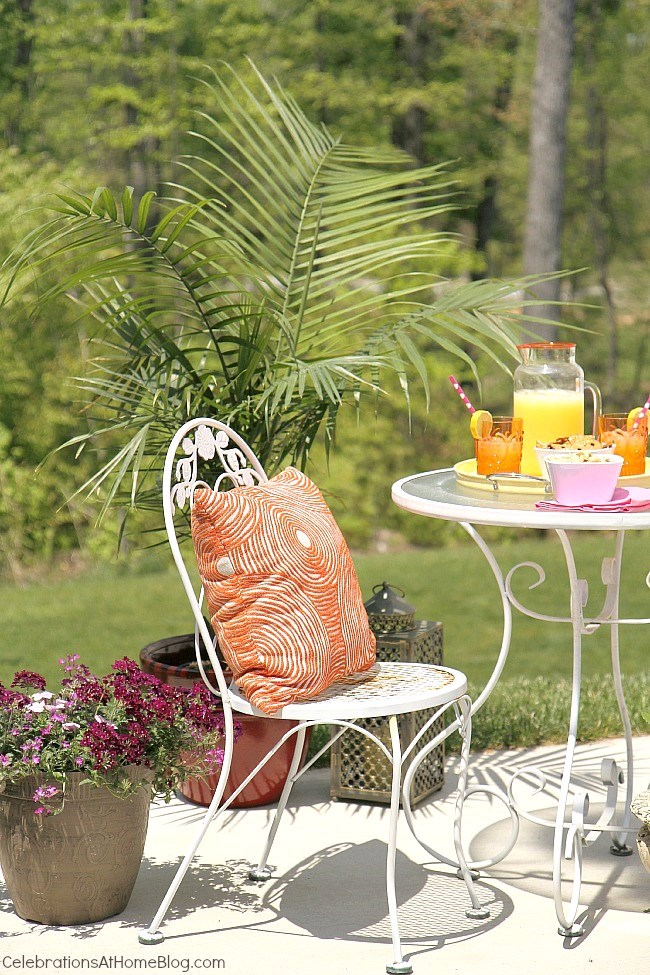 Create a cozy spot for outdoor entertaining, with flowers and plants to set the scene.