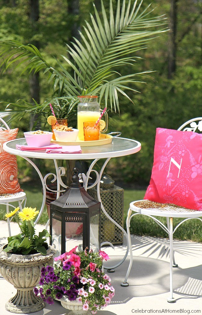 Create a cozy spot for outdoor entertaining using flowers and plants to help set the scene.