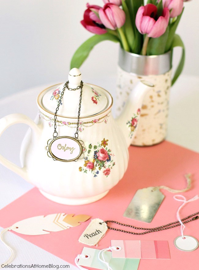 Entertaining with tea - a fun ways to dress up your tea pot and label what type or flavor the tea is inside.