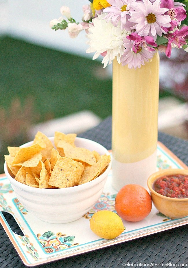 Outdoor entertaining - tray works as a centerpiece and snack holder at once.