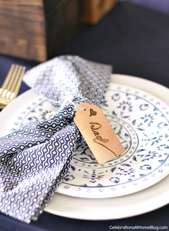 Table setting ideas for Father's Day - copper name tags and blue and white color scheme.