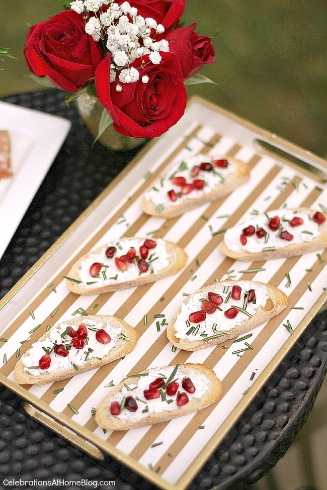 Host a summer soiree with these tips and ideas. Goat cheese baguettes with pomegranate and rosemary.