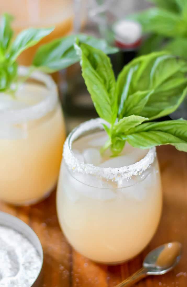 white grapefruit cocktail with basil garnish