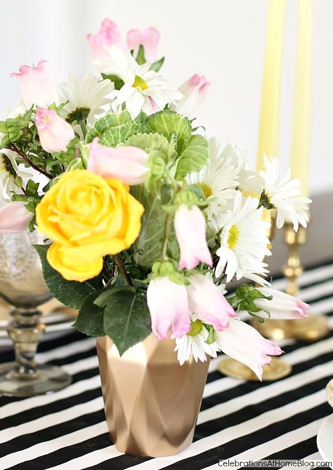 You can personalize your tabletop with just a few little details, like this spray painted tumbler turned vase!