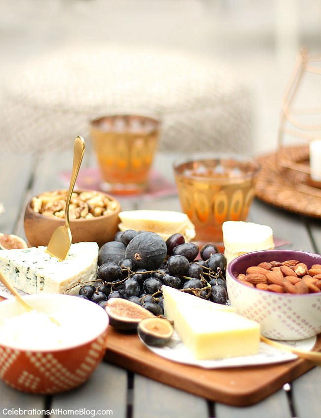 A light rustic dinner party menu for casual entertaining at home starts with a cheese board.