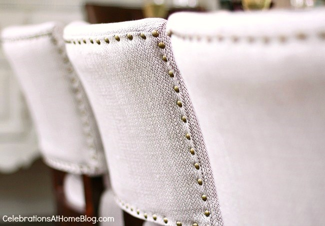Check out my dining room update and holiday entertaining tips here. - upholstered dining chairs