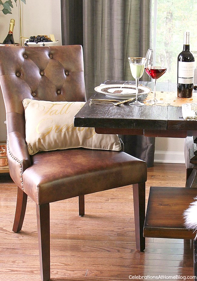 Check out my dining room update and holiday entertaining tips here. - leather dining chair