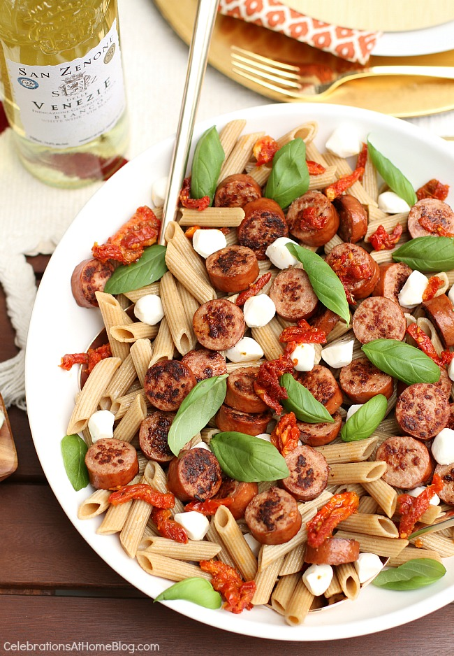 A light rustic dinner party menu for casual entertaining at home. - pasta with sausage