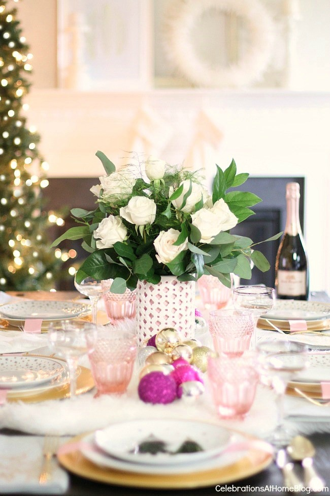 white & pink Christmas tablescape set in front of fireplace and Christmas tree